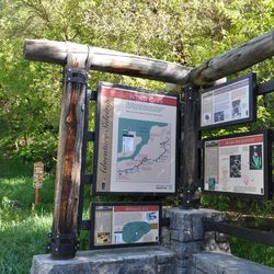 The trailhead to the Wind Caves offers information about the caves and the canyon.