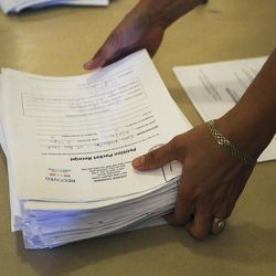 Volunteer Becky Rasmussen helps count signatures at the Capitol in Salt Lake City on Monday, Aug. 15, 2016, for a petition to put independent presidential candidate Evan McMullin on the ballot in Utah in November.