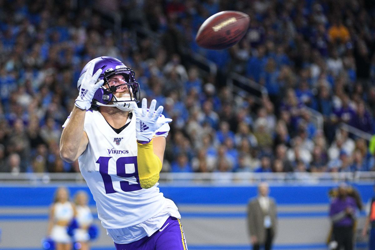 Minnesota Vikings wide receiver Adam Thielen scores a touchdown and is injured during the play during the first quarter against the Detroit Lions at Ford Field.