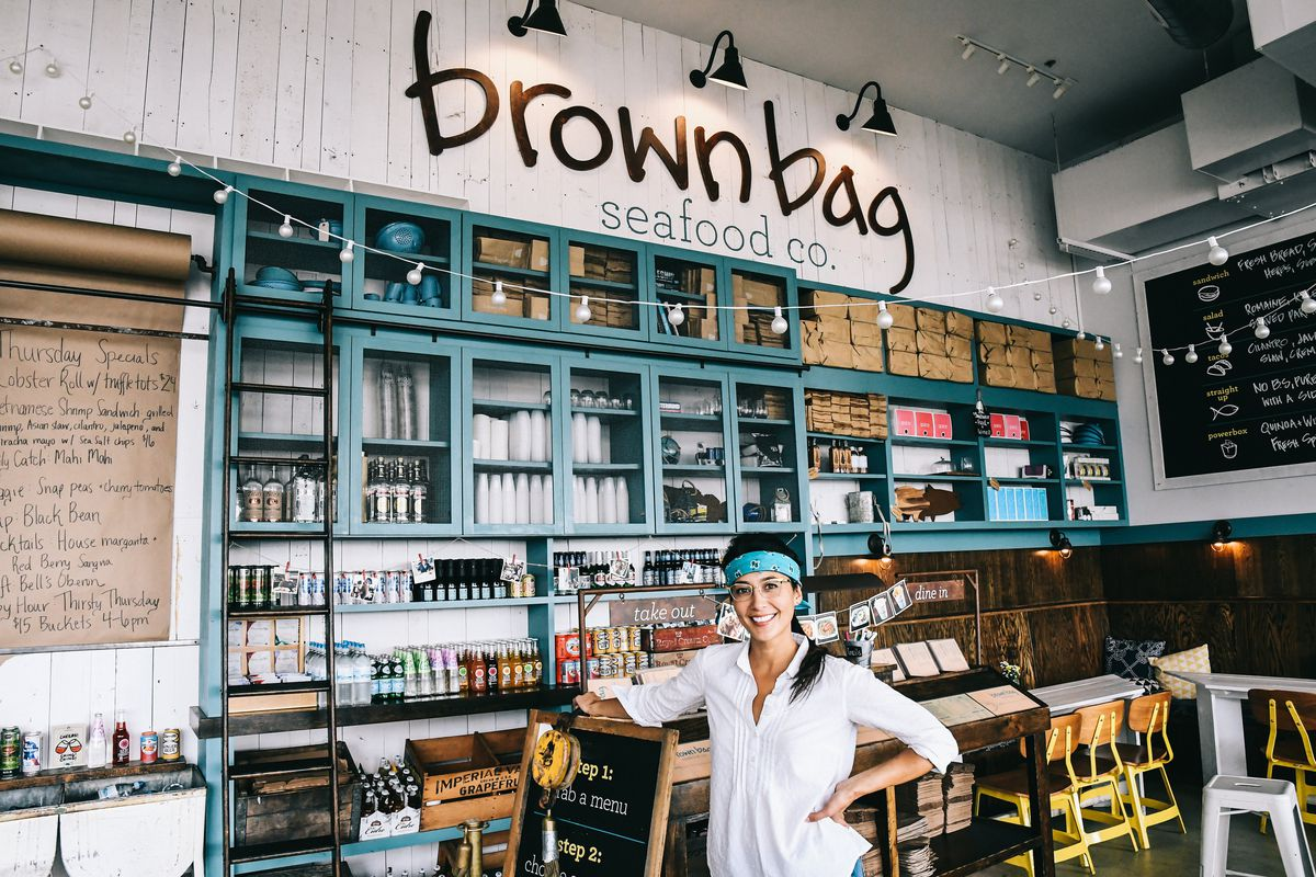 Chicago restaurateur Donna Lee standing at the counter of one of her Brown Bag Seafood restaurants