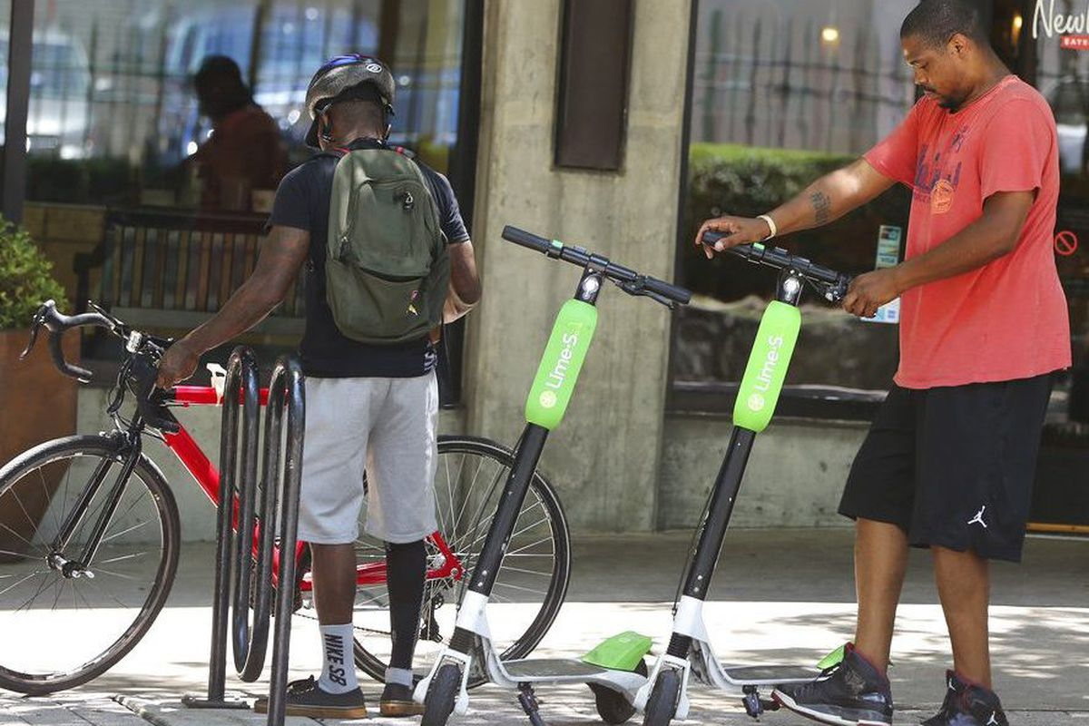 People using dockless electric scooters.
