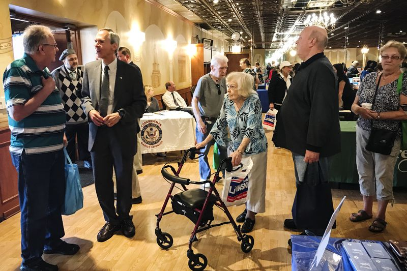 Rep. Dan Lipinski (second from the left) answers questions from elederly constituents at a senior fair in Summit, Illinois.