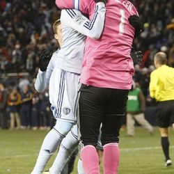 Sporting's Chance Myers jumps into the arms of 'keeper Jimmy Nielsen as Sporting KC defeats Real Salt Lake Saturday, Dec. 7, 2013 in MLS Cup action.