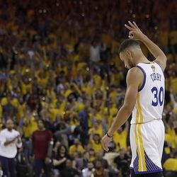 Golden State Warriors guard Stephen Curry (30) reacts after the Warriors scored against the Cleveland Cavaliers during the first half of Game 1 of basketball's NBA Finals in Oakland, Calif., Thursday, June 1, 2017.