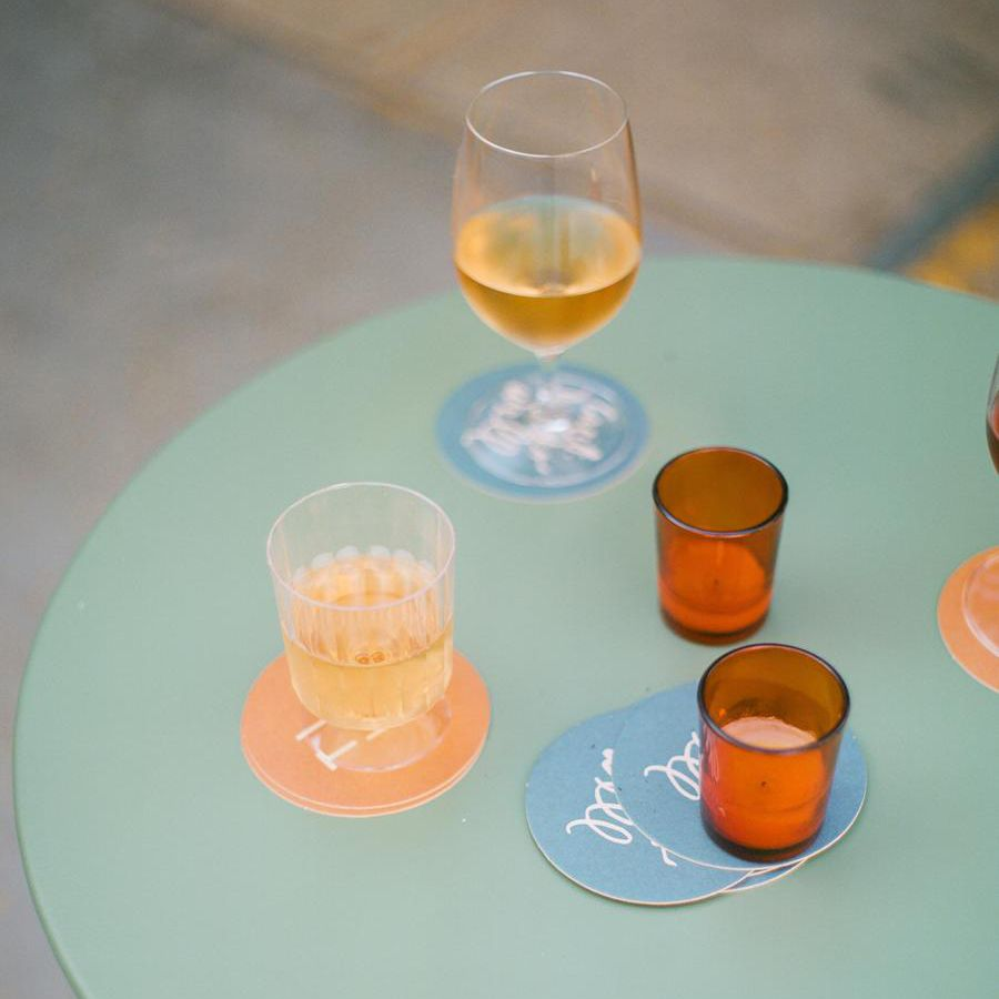 Multiple alcoholic beverages on green table