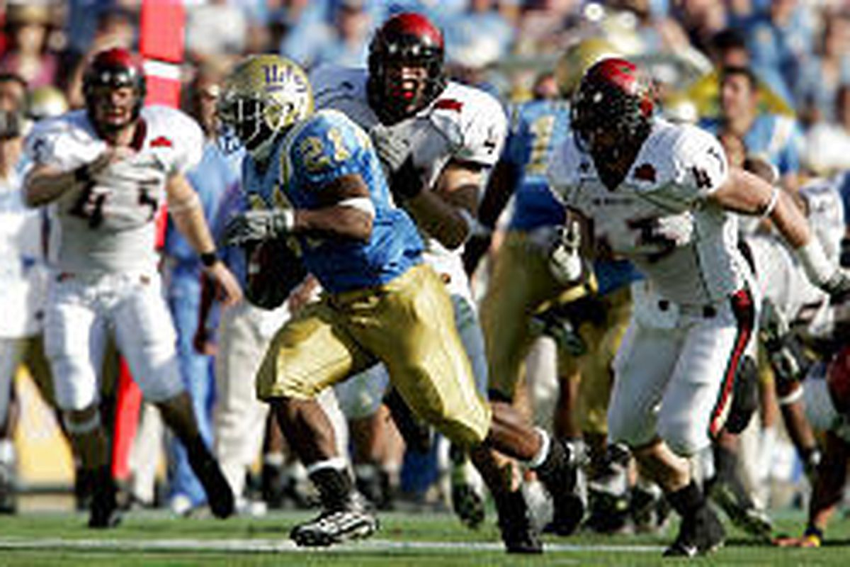 UCLA tailback Maurice Drew breaks away from the San Diego State defense and scores during the first half of the Bruins' win Saturday.
