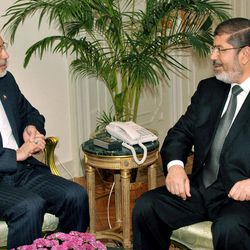In this image released by the Egyptian President, Egyptian President Mohammed Morsi, right, meets with Iranian Foreign Minister Ali Akbar Salehi at the Presidential Palace in Cairo, Egypt, Tuesday, Sept. 18, 2012.