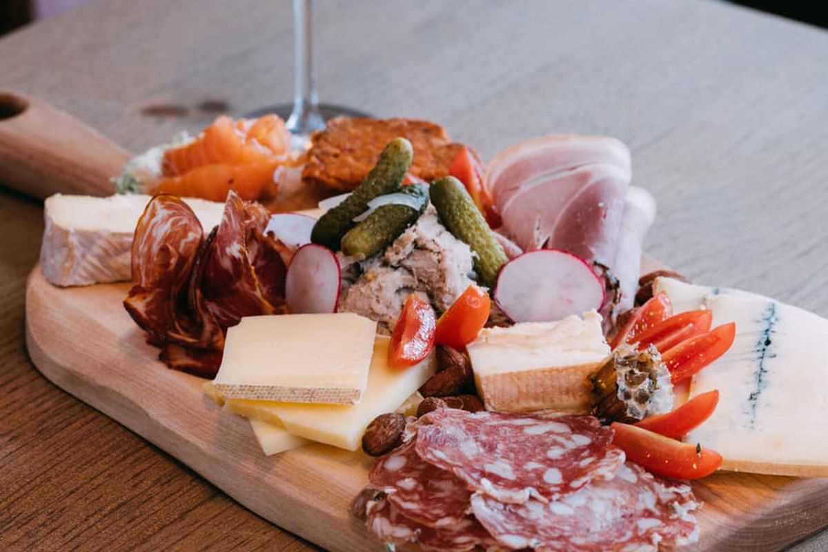 A plate of charcuterie and cheese.