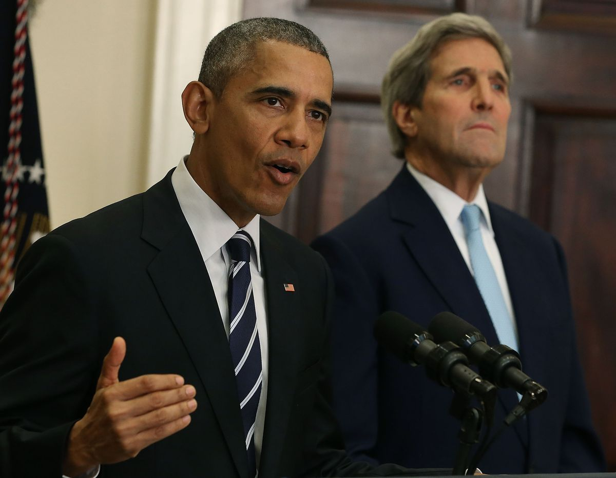 U.S. President Barack Obama, flanked by U.S. Secretary of State John Kerry (right), announces his decision to reject the Keystone XL pipeline proposal, at the White House November 6, 2015 in Washington, DC. President Obama cited concerns about the impact