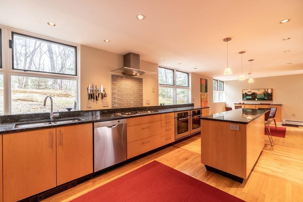 An open kitchen with a long counter and an island.