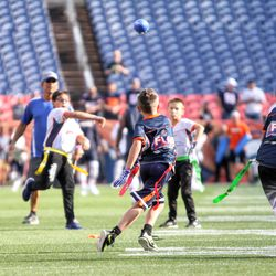 Some young people got to play their flag football game on the field before the game.