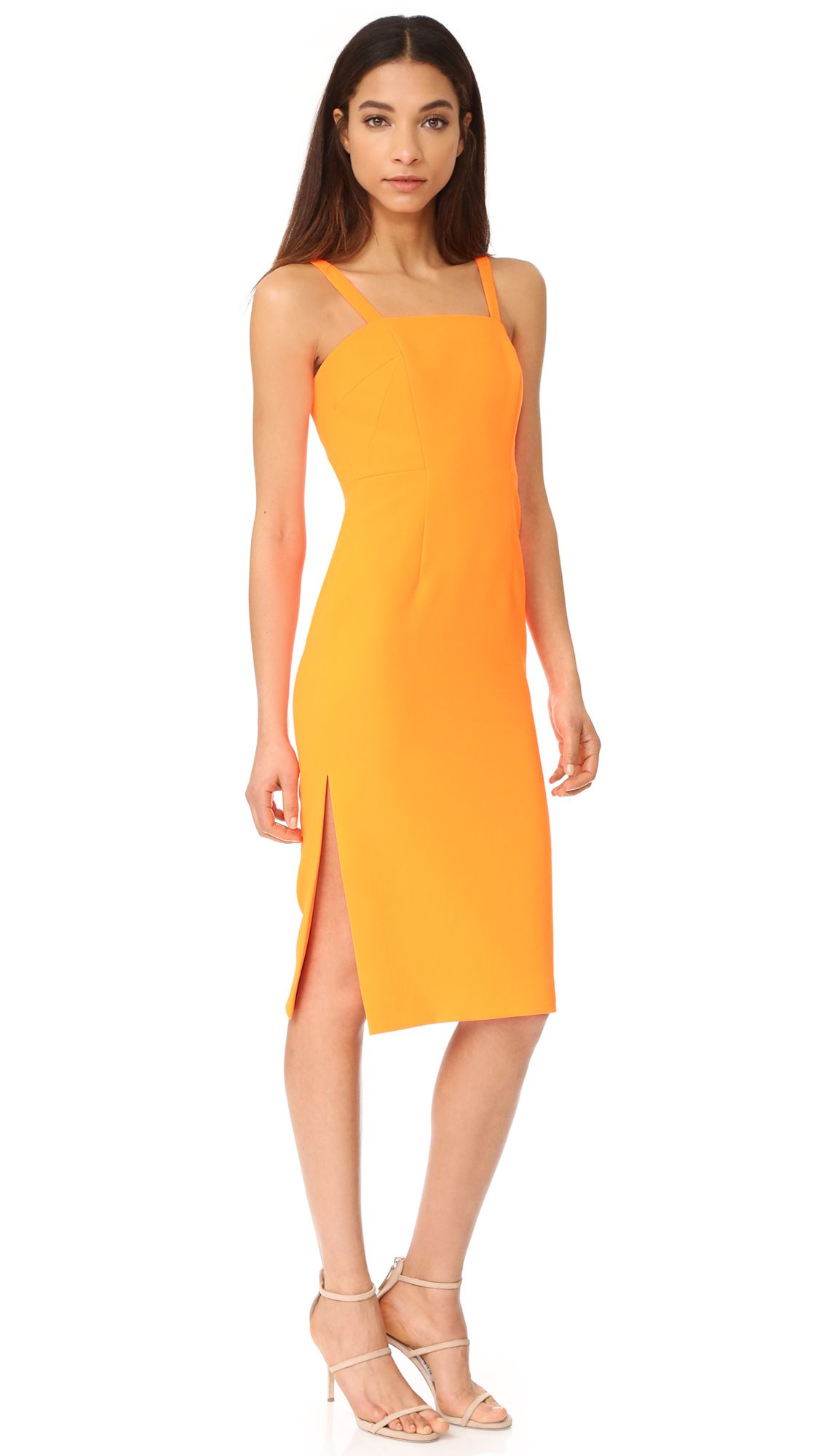 An orange fitted dress