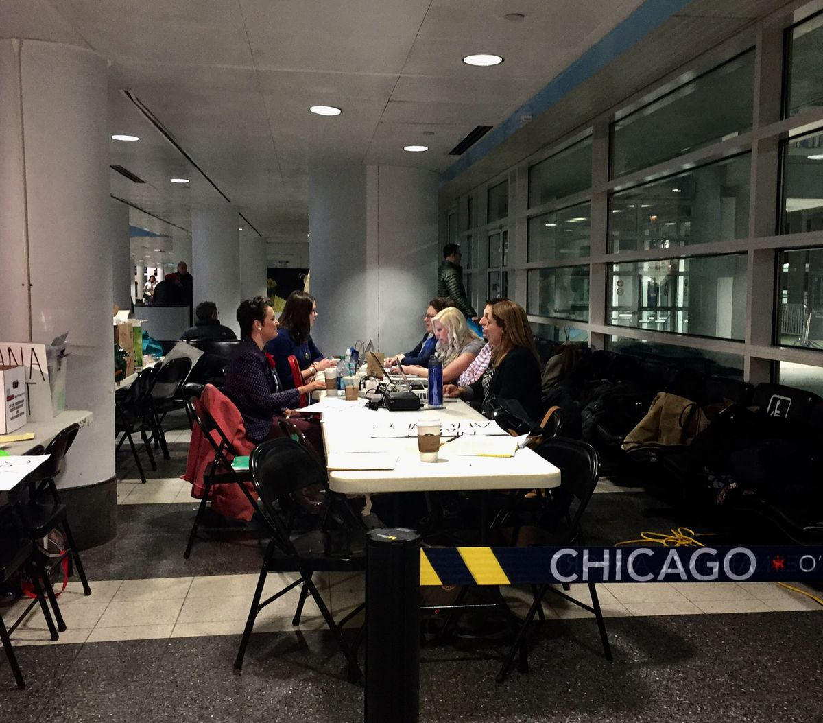 Attorneys once again gathered in O'Hare's International terminal to offer pro bono legal advice to those affected by President Trump's executive order.   Sam Charles/Sun-Times