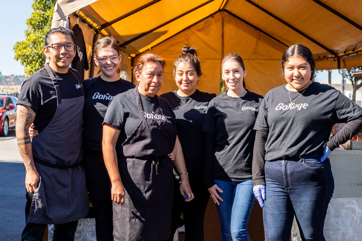 The Montano family standing in front of the El Garage pop-up