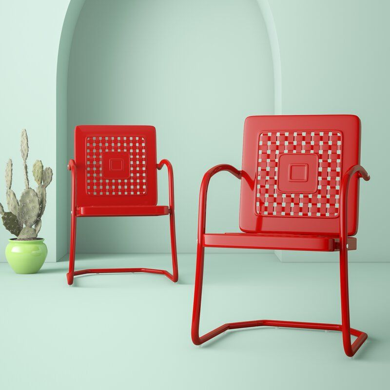 Red chair with holes in the back.
