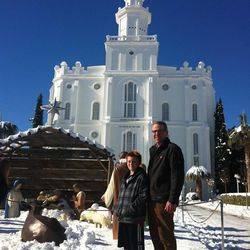 Brian Lawrence, right, and Jeremy Lawrence pose in front of the unusually snowy St. George Temple on Sunday, Dec. 8, 2013.