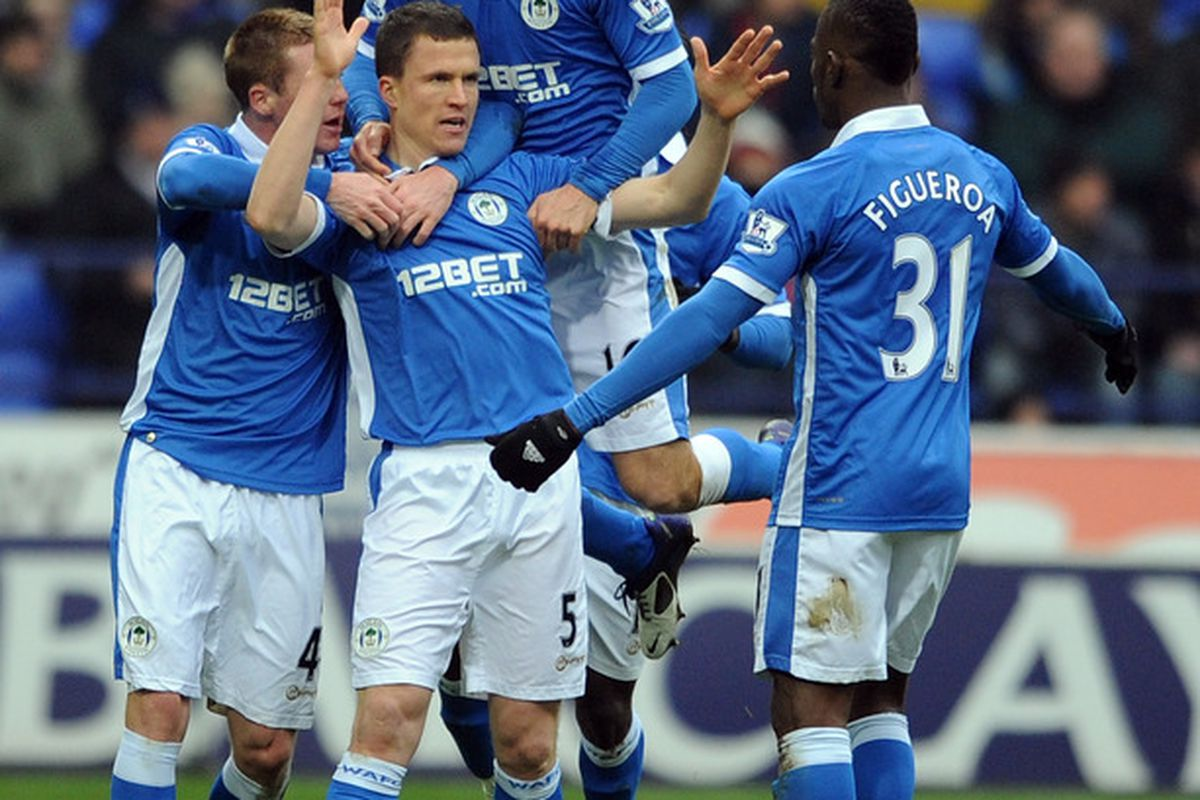 Gary Caldwell of Wigan Athletic is congratulated by his team-mates after heading the opening goal during the Barclays Premier League match between Bolton Wanderers and Wigan Athletic.