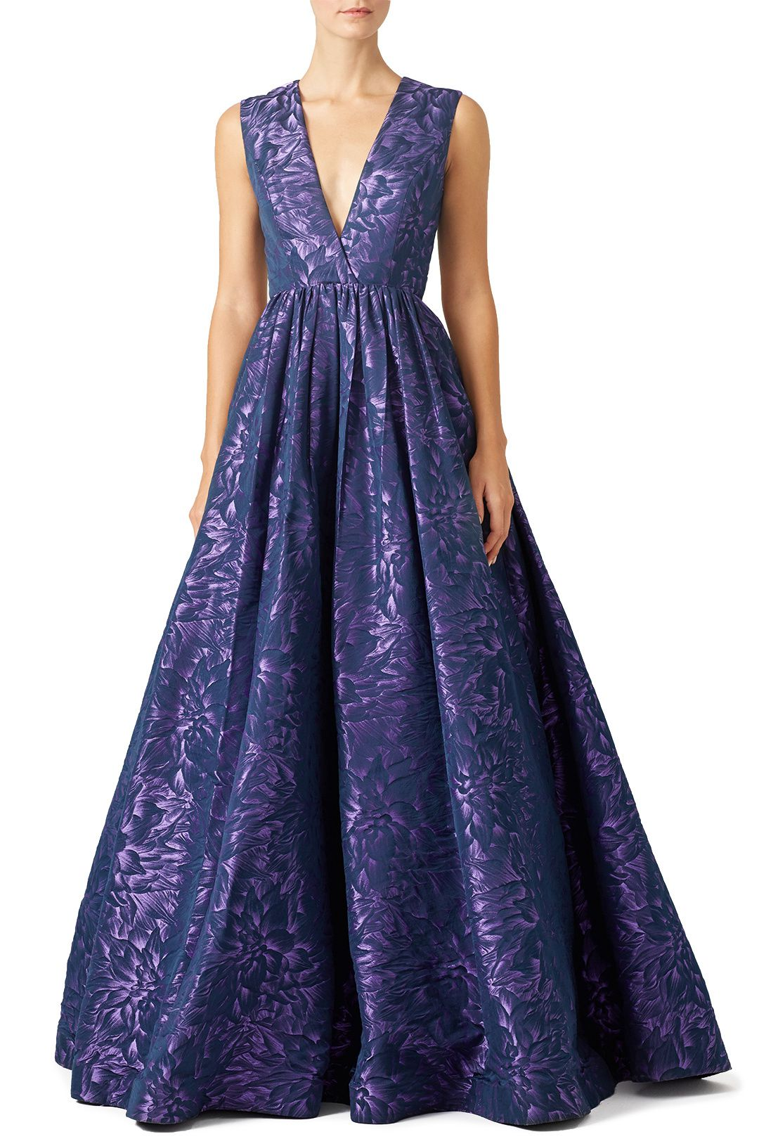 A model wearing a blue and purple formal gown