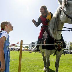 """""""Will you bring me his heart?"""" asks Rachel Johnston, 11, after Josh Avery, right, presents her with a rose before the start of a jousting competition during the Utah Renaissance Faire at Thanksgiving Point's Electric Park in Lehi on Friday, Aug. 23, 2019."""