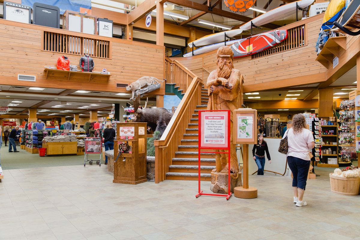 The entrance to the Kittery Trading Post, with wood carvings and boating equipment.