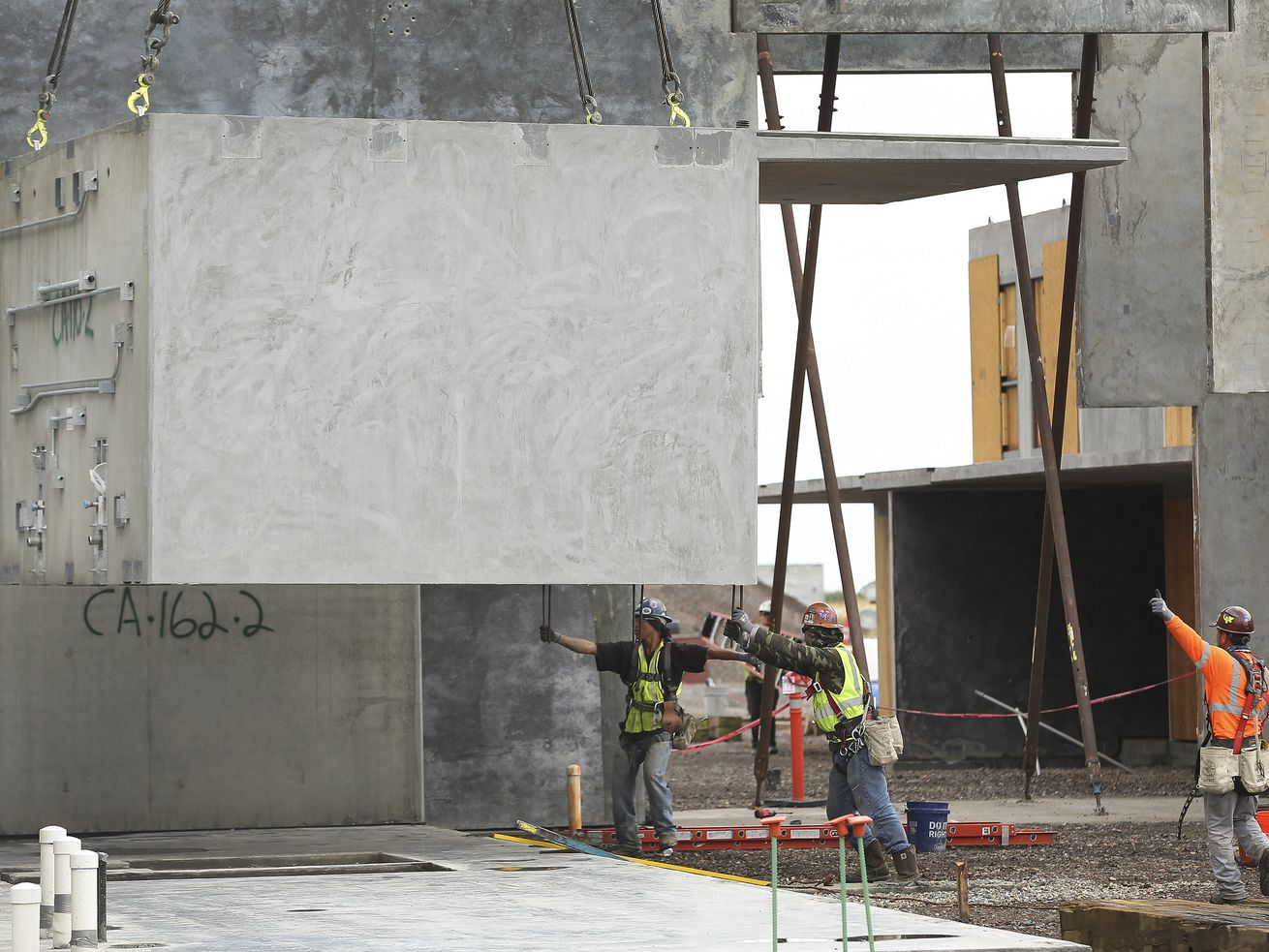 Construction crews install a men's maximum security cell module at the new state prison in Salt Lake City on Wednesday, Sept. 11, 2019.