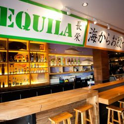 A smaller tequila-and-sake bar (made from elm) seats five; it's on the left here.