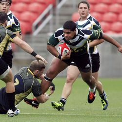UVU's #17 Malaki Tuakimoana, center, fights to get away from Lindenwood's #7 Tyler Black, down left, during Division II college rugby semifinal action between Lindenwood and Utah Valley University Friday, May 18, 2012 at Rio Tinto Stadium. Lindenwood won 57-10.