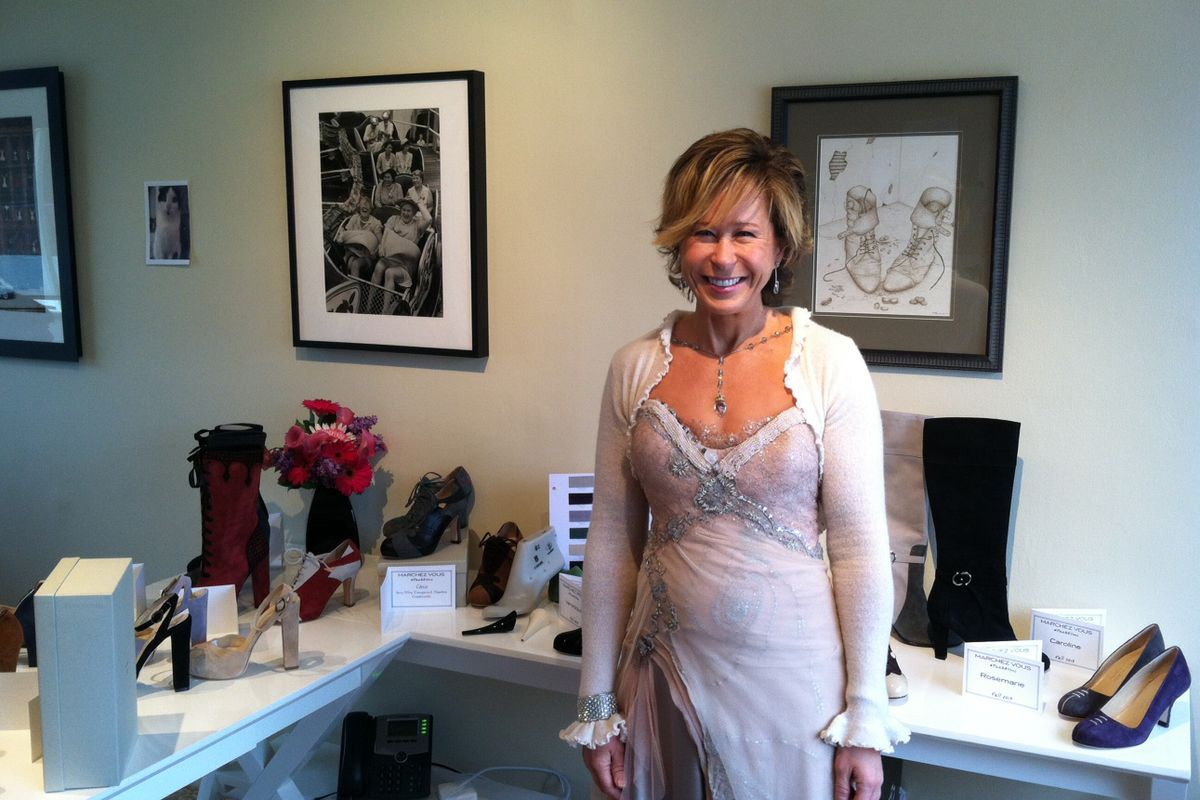"""Yeardley in front of styles from her fall 2013 collection. It was """"gown Wednesday"""" in the office."""