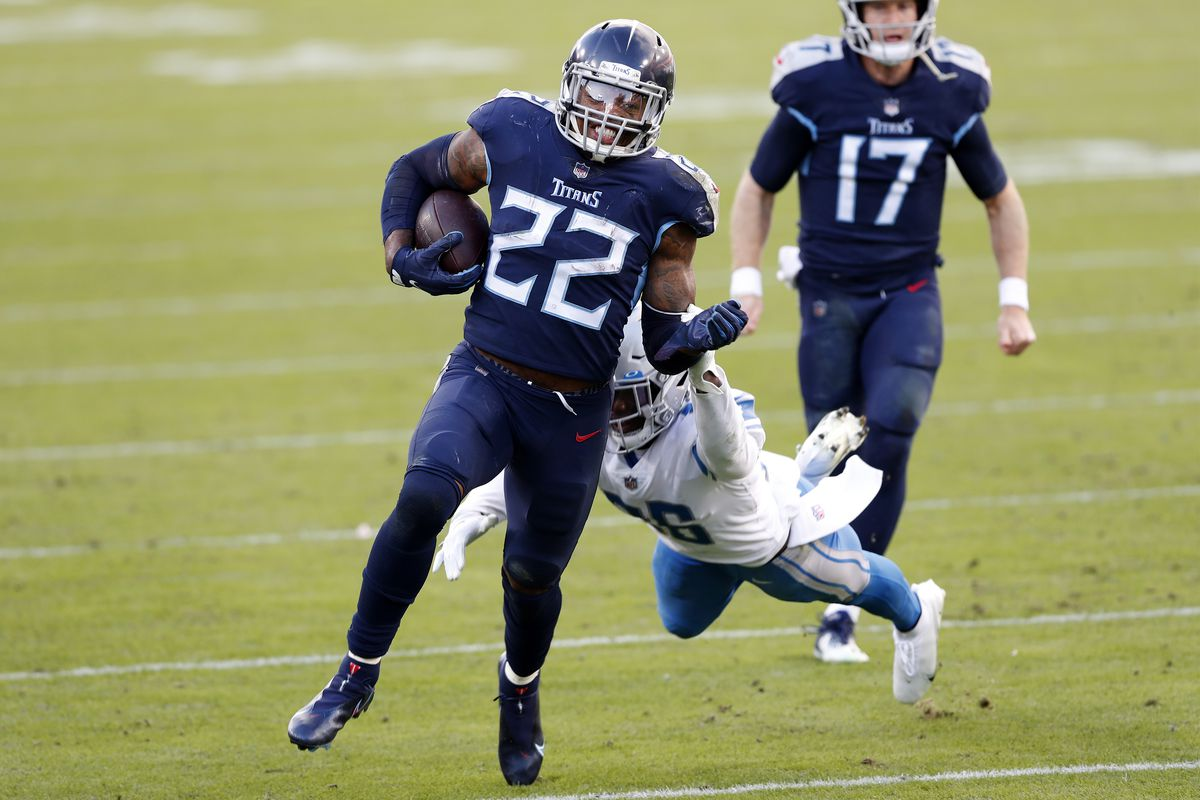 Running back Derrick Henry #22 of the Tennessee Titans carries the football over strong safety Duron Harmon #26 of the Detroit Lions during the game at Nissan Stadium on December 20, 2020 in Nashville, Tennessee.