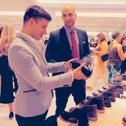 A guest shops the goods at the shoe department.