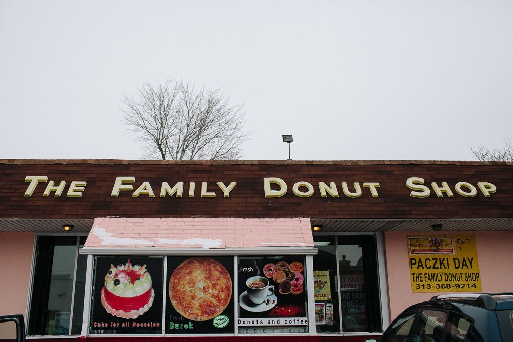 The pink exterior and wood awning for the Family Donut Shop in Hamtramck.