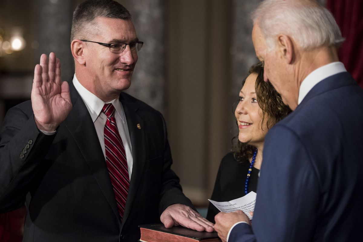 Senator John Walsh reenacts his swearing-in ceremony with Vice President Joe Biden.