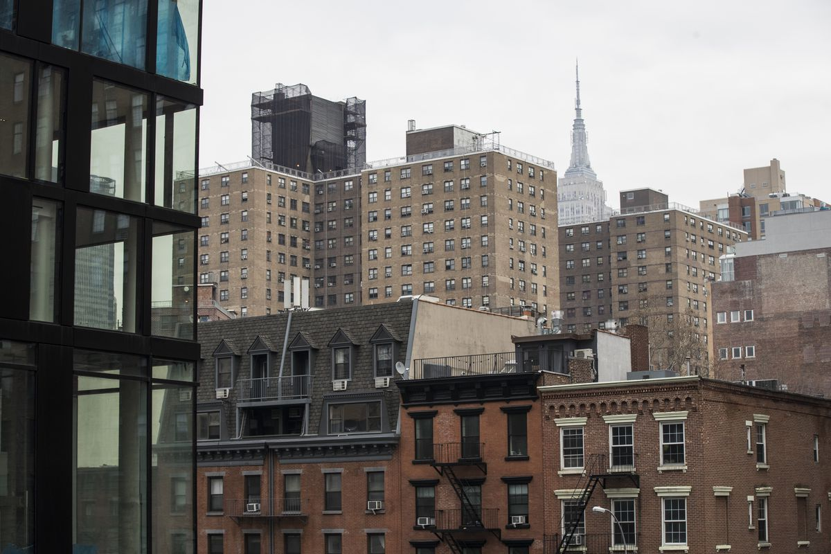 View of New York City buildings and the Empire State behind them.
