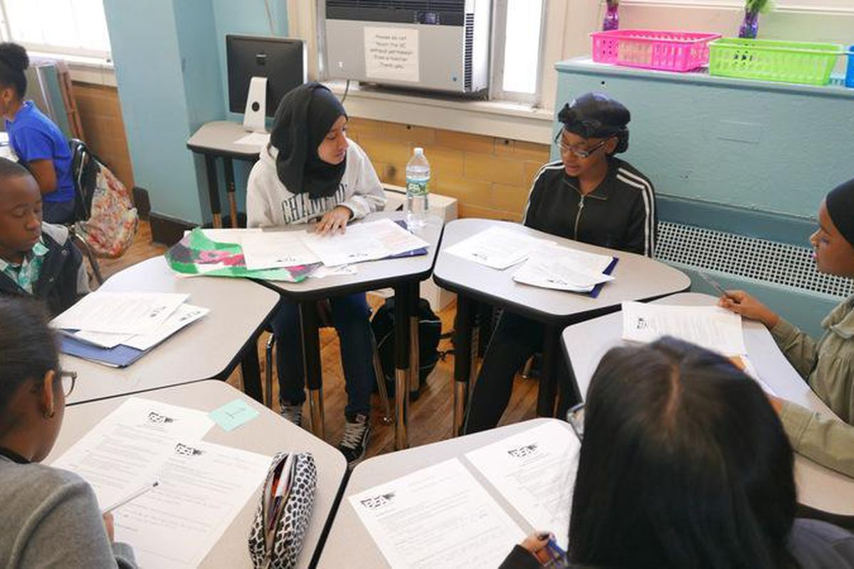 Students at Bronx Envision Academy participate in a portfolio roundtable in 2018.