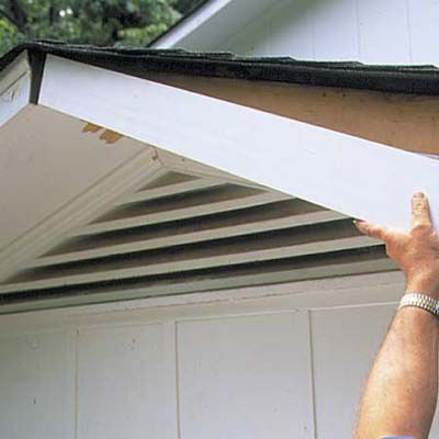 Man Attaches Replacement Fascia To Roof