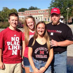 Steve, Megan and Felicia Keiser pose with their dad, Ray Keiser. They always go to the Huskers games together. Felicia has testified at the Nebraska Legislature about the need for a shared parenting law, after her parents' divorce.