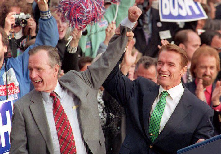 George H.W. Bush and Arnold Schwarzenegger at a campaign event in 1992. (David Ake/Getty Images)