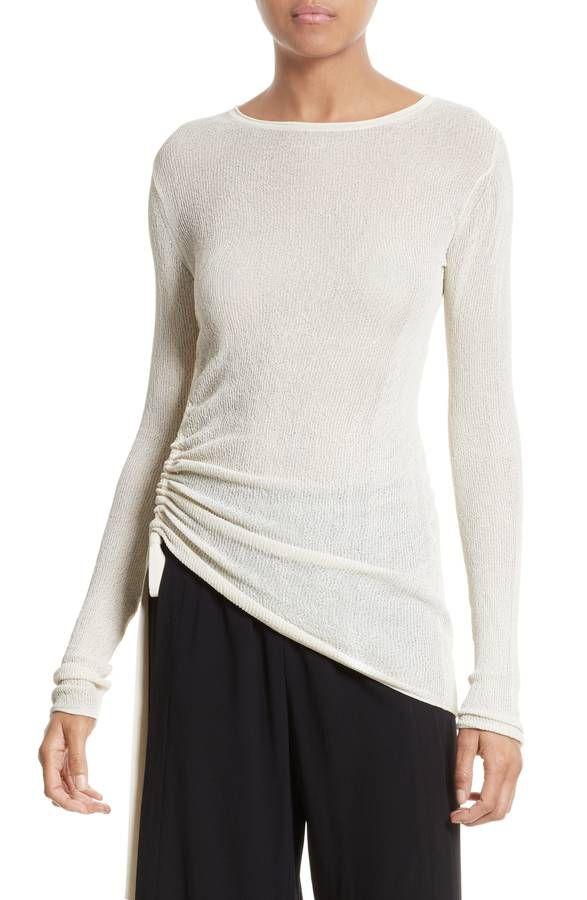 Model in white crepe pullover sweater