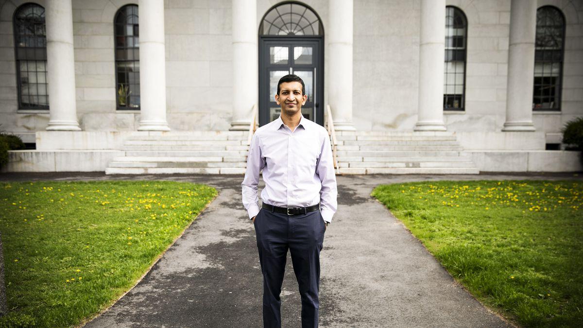 Harvard economist Raj Chetty stands in front of the home of the Department of Economics, on Harvard University's campus in Cambridge, Massachusetts.