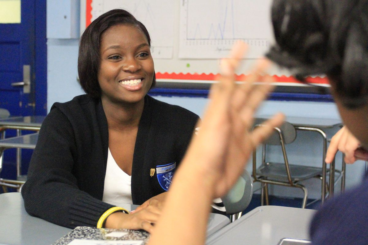 Dennique Khanns, 16, talks with a fellow Fordham High School for the Arts junior after their OneGoal class.