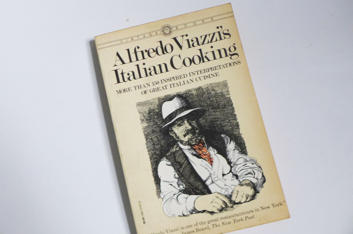 A cookbook with a sketch of the chef.