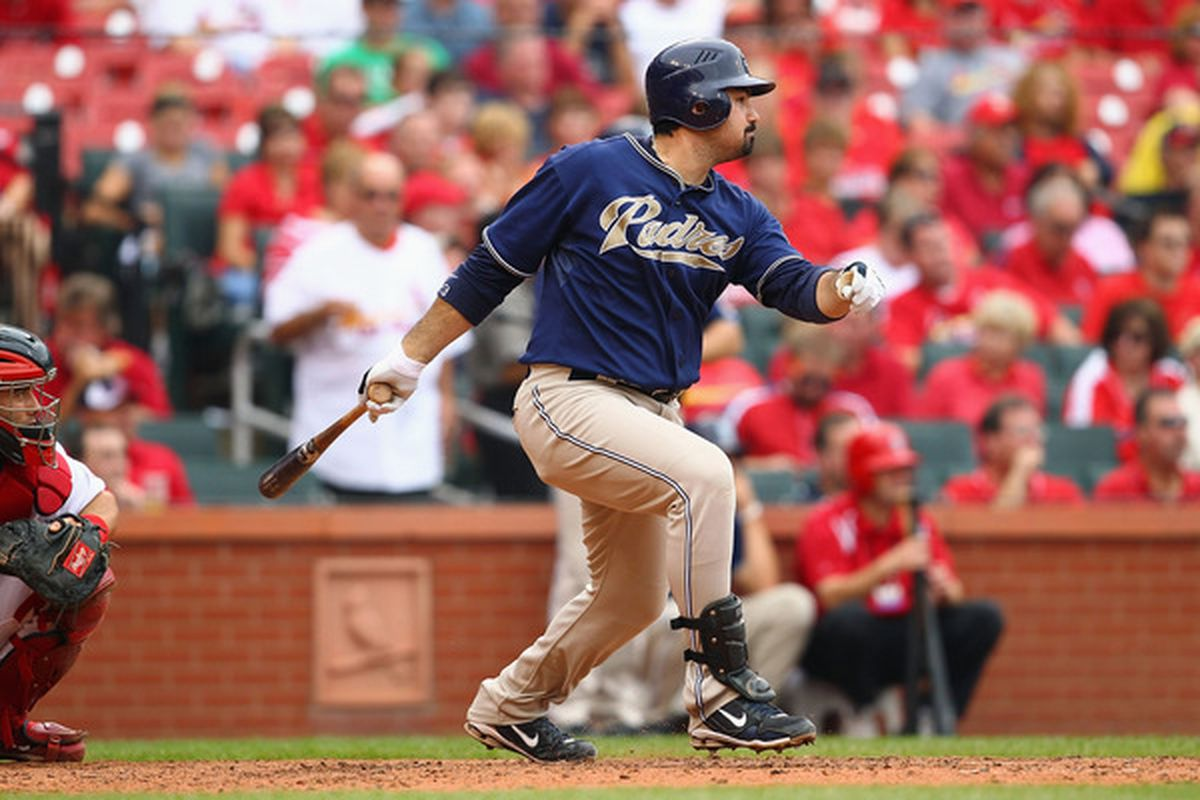 Adrian Gonzalez of the San Diego Padres hits an RBI single against the St. Louis Cardinals at Busch Stadium in St. Louis Missouri. But he's not on the Padres any more.  (Photo by Dilip Vishwanat/Getty Images)