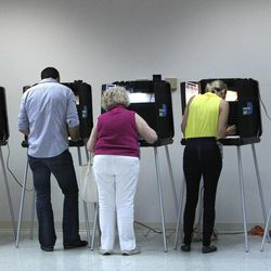 People vote on Election Day Tuesday, Nov. 6, 2012, in Miami.