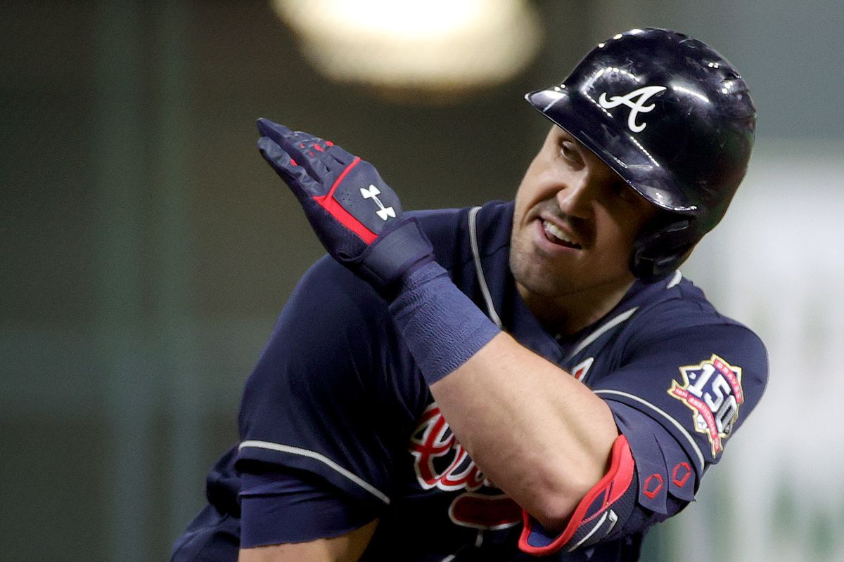 Adam Duvall #14 of the Atlanta Braves celebrates after hitting a two run home run against the Houston Astros during the third inning in Game One of the World Series at Minute Maid Park