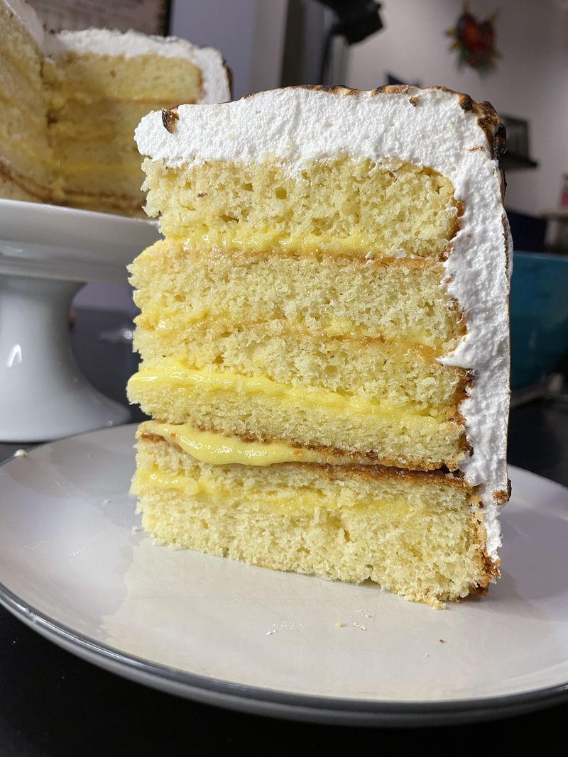 A slice of layered lemon cake.