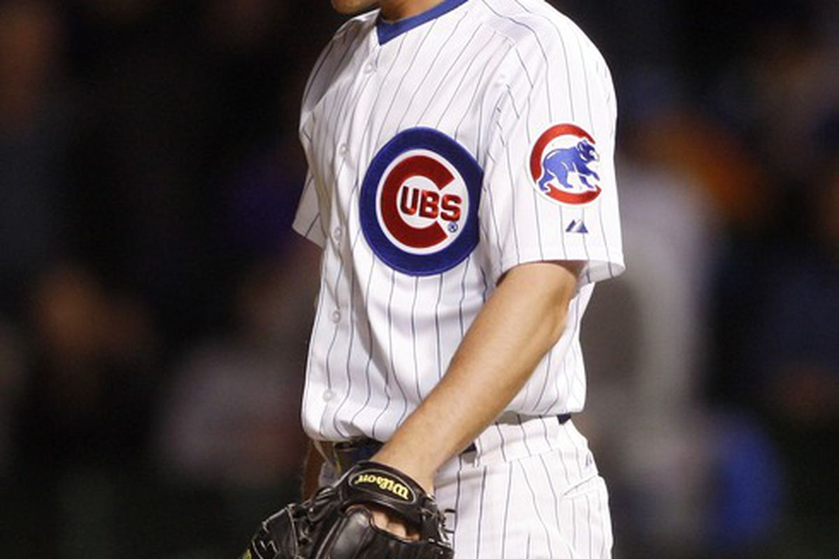 Chicago, IL, USA; Chicago Cubs relief pitcher Michael Bowden reacts after giving up a grand slam to Philadelphia Phillies pinch hitter Hector Luna during the ninth inning at Wrigley Field. Credit: Jerry Lai-US PRESSWIRE