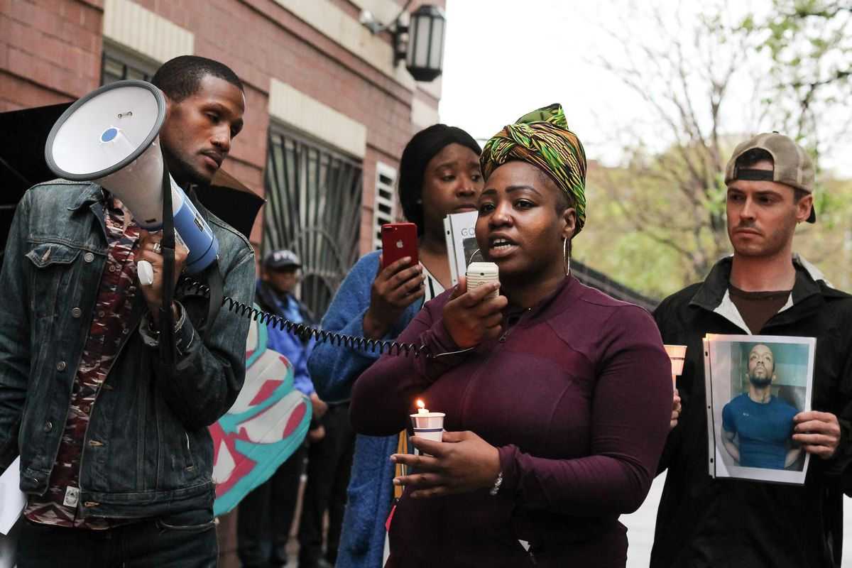 Activists and community members at a vigil decry the NYPD killing of Kawaski Trawick in The Bronx last year.