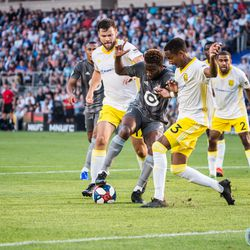 July 10, 2019 - Saint Paul, Minnesota, United States - Kevin Molino gets between a few New Mexico players during the quarterfinal match of US Open Cup between Minnesota United and New Mexico United at Allianz Field. (Tim C McLaughlin)