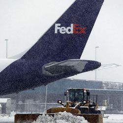 A plow works during a snowstorm at Salt Lake City International Airport, Thursday, Dec. 19, 2013.