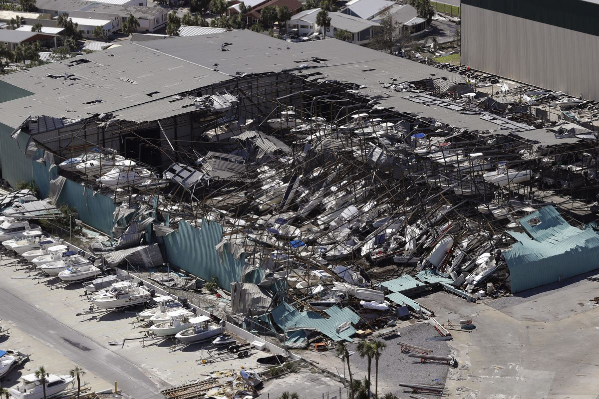 A roof over a boat storage building is collapsed following Hurricane Michael on Thursday, Oct. 11, 2018, in Panama City Beach, Fla. Hurricane Michael made landfall Wednesday as a Category 4 hurricane with 155 mph winds and a storm surge of 9 feet. (AP Pho